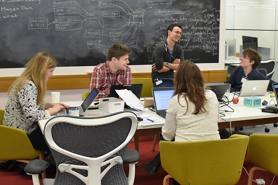 Data science students working together at a table