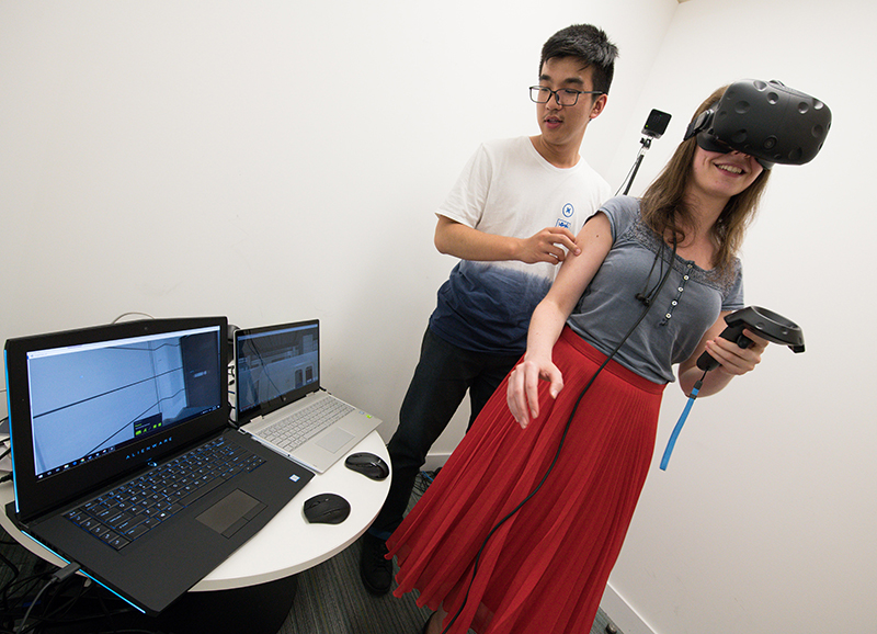 Two people participate in a virtual reality experiment at The Alan Turing Institute. Photo by Arif Gardner.