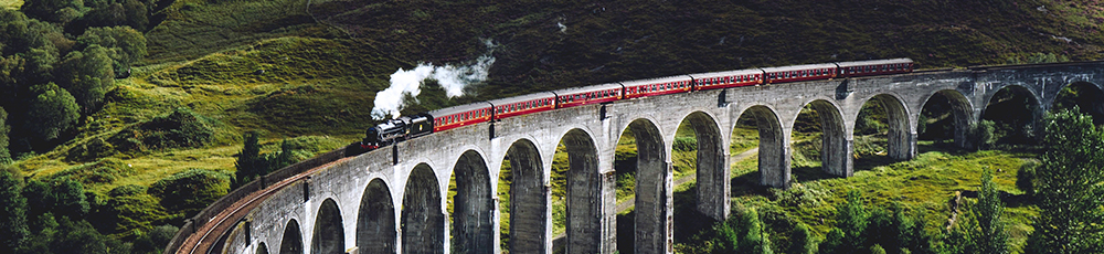 Steam train going over a viaduct